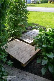 wooden garden walkway an easy 2 pallet garden walkway you can make in a quick afternoon