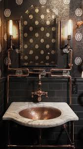 Exposed copper piping against black tile and wallpaper creates a beautiful  focal point in this steampunk-inspired powder room. Also used for the  fixtures ...