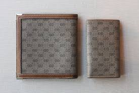 gucci key case. vintage gucci logo wallet and key case