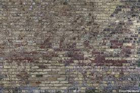 a vintage brick wall mural printed on removable wallpaper sold by aboutmurals ca