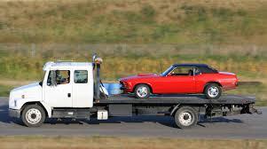 TruckTowingCar ImagineGolf E 56a1def53df78cf7726f5fce