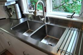 stainless steel countertop with integrated sink. Stainless Steel Integrated Sink Throughout Countertop With