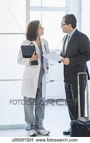 Pharmaceutical Representative Stock Photo Of Pharmaceutical Representative Talking To Female