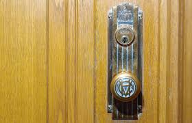 the original door s at vancouver s city hall are being replaced with new handles to meet