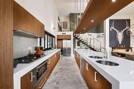 How Big Is A Kitchen Island A Big Wooden Kitchen Island With White Countertop And Storage