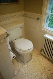 brown floor tile bathroom. bedroom, subway wall tile bathroom black wooden door tan floor rectangular mirror with white frame brown