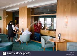 Waiter Serving Passengers In The Chart Room Bar On Cunard