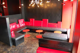 Policys ground level restaurant and bar have black and red decor