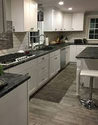 white kitchen cabinets with black countertops. Tuscany White Kitchen Cabinets With Black Countertops