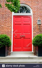 House with bright red door on Smith Row, N Street NW in Georgetown ...