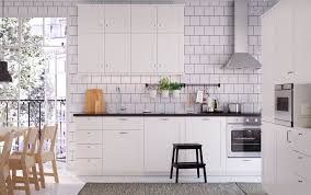 kitchen furniture white. A White Medium Size Kitchen With Black Worktops, Handles And Knobs. Combined Stainless Furniture N