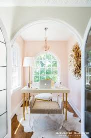 pink home office. arched french doors open to a small pink home office is clad in walls painted n