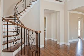 Plain Cream Wall Paint Color Background Combined With Decorative Corner  Curved Staircase Plus Railing Set Design
