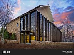 Glass exterior modern office Aluminum Storefront Modern Brick And Glass Home Or Office Or Retail Building Exterior In The Woods At Sunset Bigstock Modern Brick Glass Image Photo free Trial Bigstock