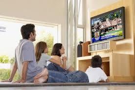 watching tv at home. menonton televisi lebih dari 2 jam dalam satu hari, dapat menggiring anda cepat pada kematian, demikian klaim peneliti. watching tv at home