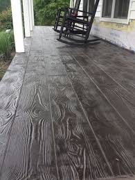 Stamped overlay - lots of great pictures of options. looks like needs to be  prof done. Wood plank pattern :: stamped concrete overlay in Stuart, VA