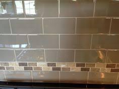 White subway tile with accent stripe Backsplash Pinterest