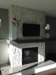 white stone fireplace with gray walls
