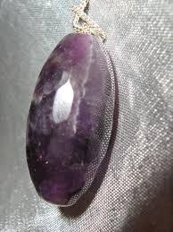 facet cut large amethyst pendant on a silver necklace