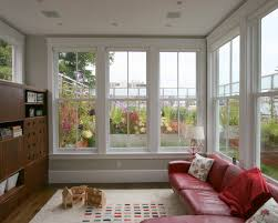 Sunroom windows -- contemporary family room by Feldman Architecture, Inc.
