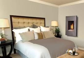 master bedroom with fireplace designs with wall mounted electric fireplaces and black varnish wooden round side bed tables and dual table lamps and black