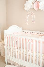 blogger katelyn jones a touch of pink pretty nursery pottery barn crib