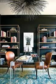 black walls gold shelves lucite wool carpet leather chairs designed by amy morris meghan carlson wise new house dining room