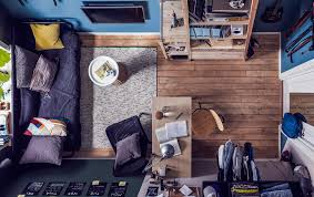 Aerial view of a small teen bedroom with a day-bed, study area and
