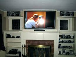 tv above fireplace hiding wires mounting above fireplace how to mount television over fireplace mounting above