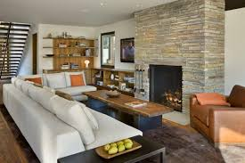 Living Room Fireplace Designs Stacked Stone Fireplace Designs And The Decors Around Them