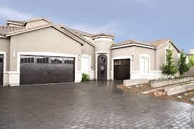 customized wood garage door model 7103 mustang with custom stain finish and 16 lite arched windows on the property brother s home in las vegas nv