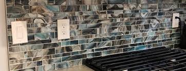 Tile backsplashes, of course, are lovely, but if you don't fancy cleaning all those grout lines, or you're just looking for something a little more sleek and modern, why not try a glass backsplash? Page 5 Backsplash Discount Glass Tiles Modern Glass Tile Belk Tile