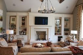 traditional living room with tv. Black Iron Medieval Chandelier With Brown Sofa For Traditional Living Room Ideas White Decorative Fireplace And Small Modern TV Tv V