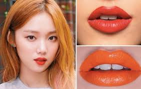 orange and red lips if there are any colours that you should invest they ll have to be bright orange and red these dramatic shades applied in either