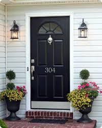 black front door with kick plate door knocker and house number weling entrance
