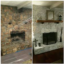 white wash rock fireplace 50 white primer 50 water brush on and dab with a wash cloth