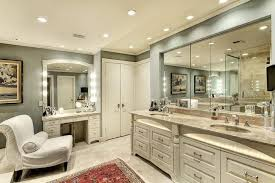 master bathroom iluminated with recessed lights and vanity bar lights
