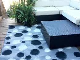 outdoor rug with painted black and white dots