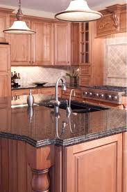 coffee brown paired with diffe shades of brown everywhere you look in this kitchen