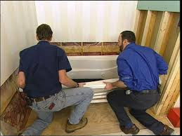 carefully manuever the tub into its place