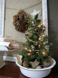 This is a super simple, vintage solution for a small tabletop tree. (via