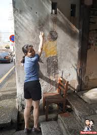 lebuh cannon reaching up boy penang street art painting on famous wall art in penang with penang street art painting step by step walking guide what to see