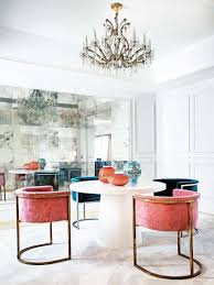 glamorous dining room with pink velvet dining chairirrored wall