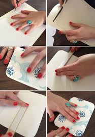 remove the paper from the double stick tape on the popsicle stick and then press the fan to close