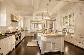 massive white kitchen with ornate coffered ceiling in galley layout with large center island