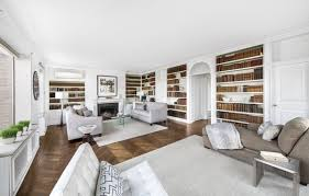 the 28 foot corner living room features built in bookshelves a wood