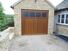 woodrite coleshill cedar wood timber door installed inbetween single stone detached garage doors n73 garage