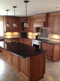 Black Granite Countertops With Tile Backsplash Fascinating Black Granite Countertops In A Classic Wooden Kitchen With Kitchen