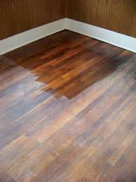 How to reseal hardwood Using a sponge mop, apply the new finish evenly over  the floor, working from the rear corner of the room toward the doorway.