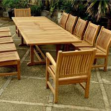 valencia sahara 13 piece teak patio dining set w 79 x 43 inch rectangular double extension table by anderson teak ultimate patio